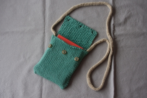 a small bag with i-cord and buttons